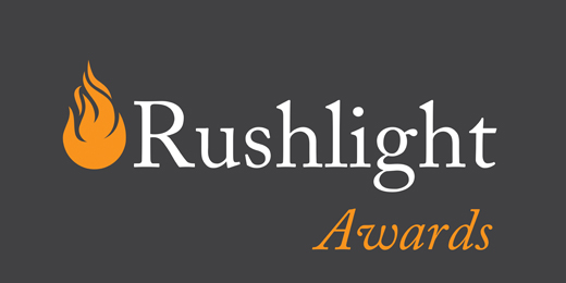 Rushlight Awards logo on grey cmyk