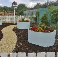 Murphy given award for eco garden at depot from waste building products